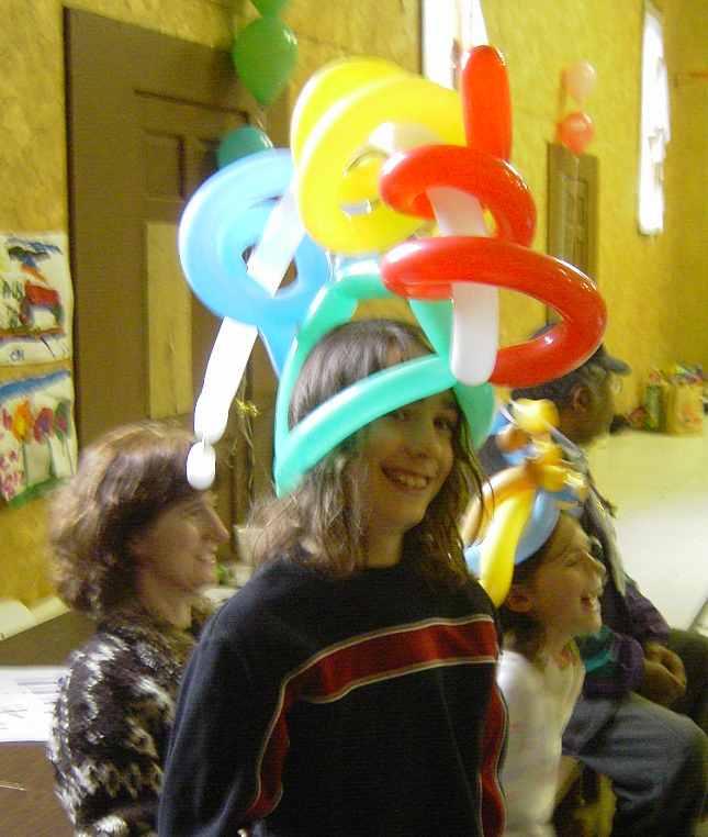 Happy boy in a VERY fancy hat!