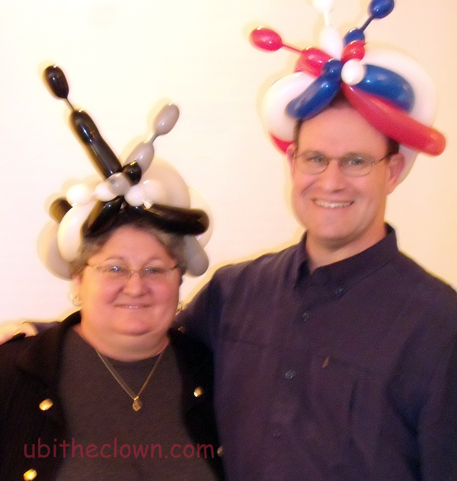 His and her balloon hats.