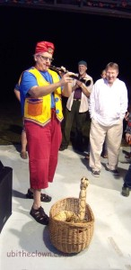 The snake charmer in action. (Live video nearby.)