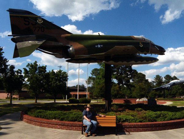 John posing with a F4 phantom fighter jet at Seymour Johnson AFB, in Goldsboro NC.