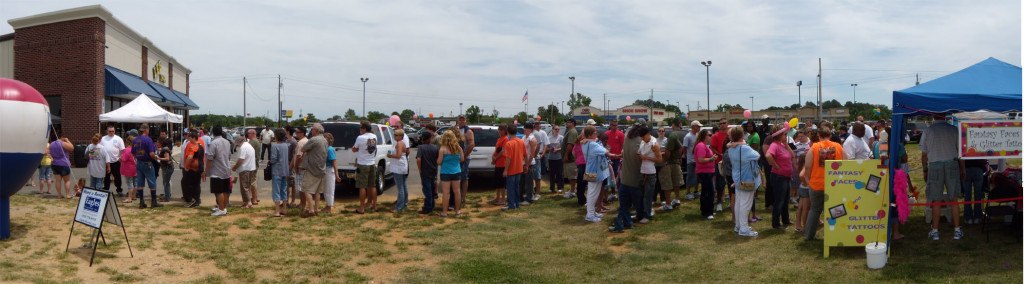 People waiting in line to get an autograph from the Lizard Lick Towing and Recovery team at the Lee, Inc., birthday celebration in Mount Olive, NC.