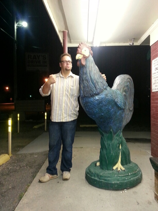 Sean Hogan with giant chicken in Wilson, NC.