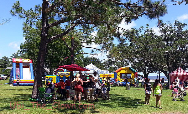 Activities in the children's area included balloon animals (front), hooping (in the white tent), and bouncy houses.